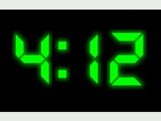 Bildschirmschoner der eine vollflächige Digitaluhr zeigt.